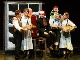 Elliot Ross, Holly Blair, Robert Rowe, Benedict Waring, Maxwell Tyler, Alyssa Noble and Claire Cartwright as Bob Cratchit, Mrs Crachit, the Ghost of Christmas Present, Ebenezzer Scrooge, the Narrator, Little One and Martha